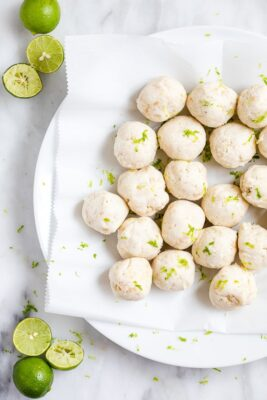 key lime fat bombs on a plate with limes