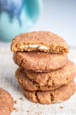 A stack of Pumpkin Snickerdoodle Cookies with Cream Cheese Filling