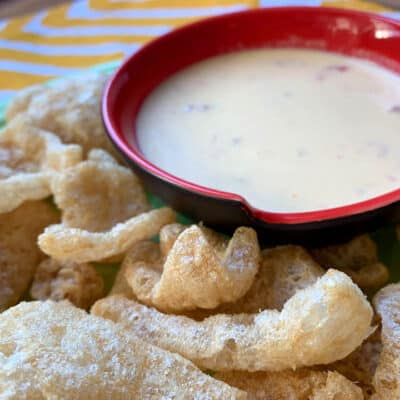 queso in a pot with pork rinds