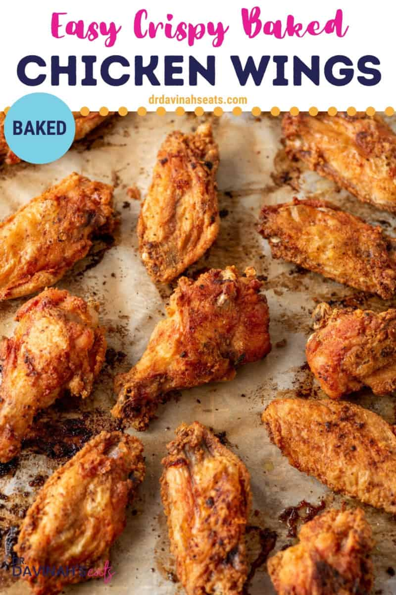 pinterest image with baked chicken wings on a baking sheet