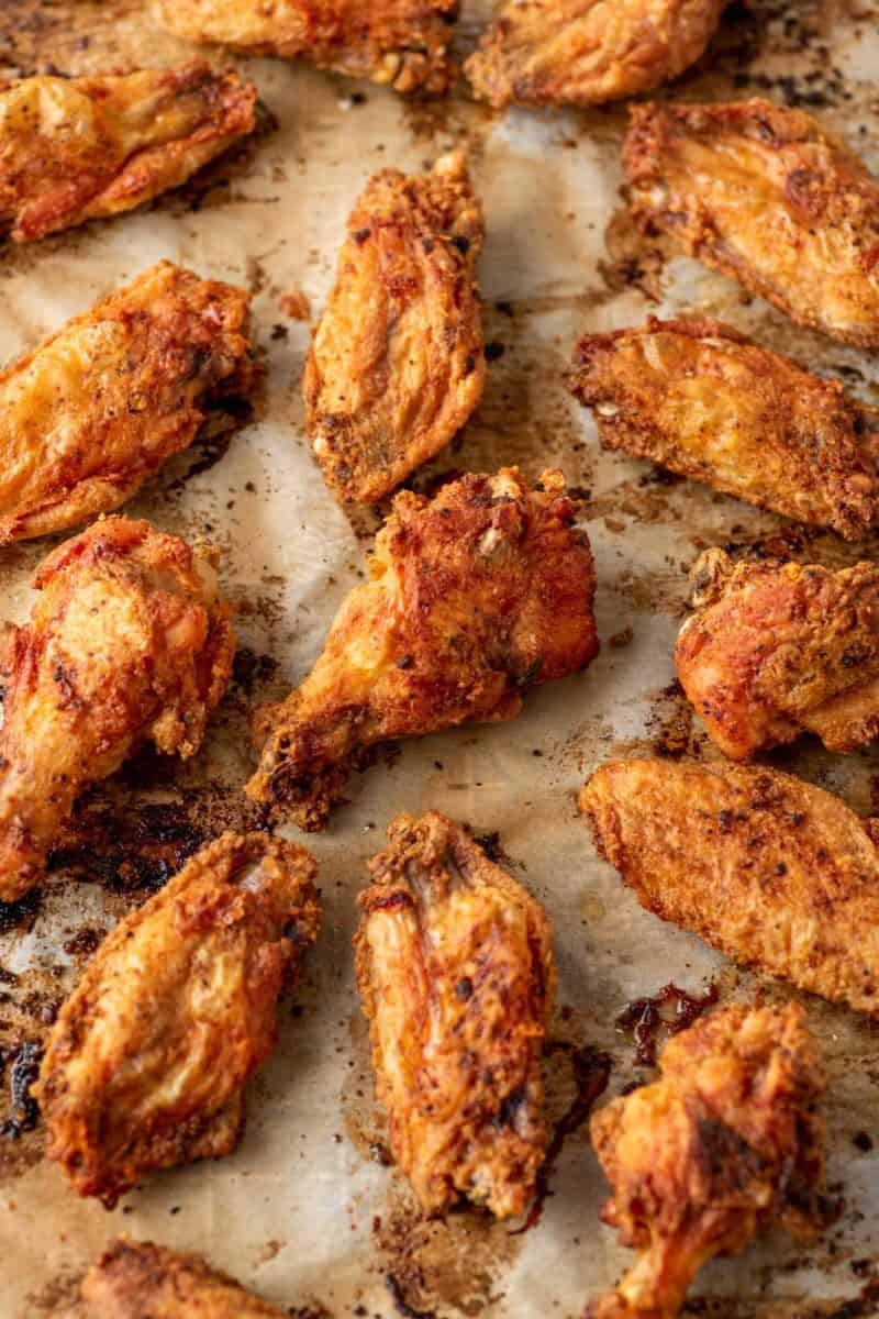 baked chicken wings on a baking sheet lined with parchment paper