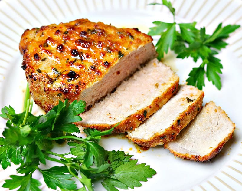sliced Ninja Foodi air fryer pork chop on a plate