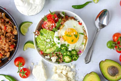 One Breakfast Bowl with sunny-side-up egg topping