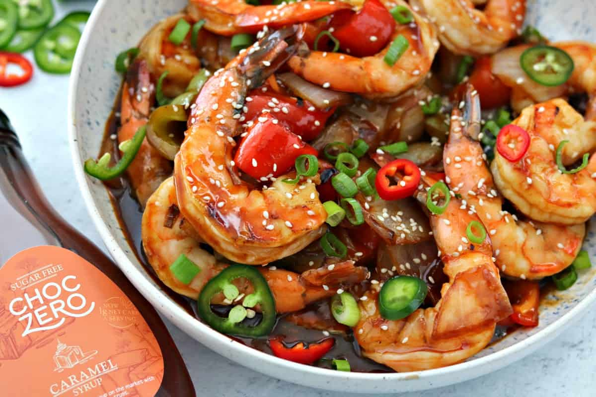 Keto Sweet and Sour Shrimp in a bowl next to ChocZero Sugar Free Syrup