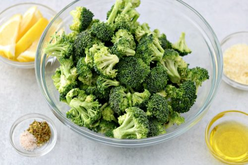 One bowl of broccoli with olive oil, lemon, parmesan and seasonings