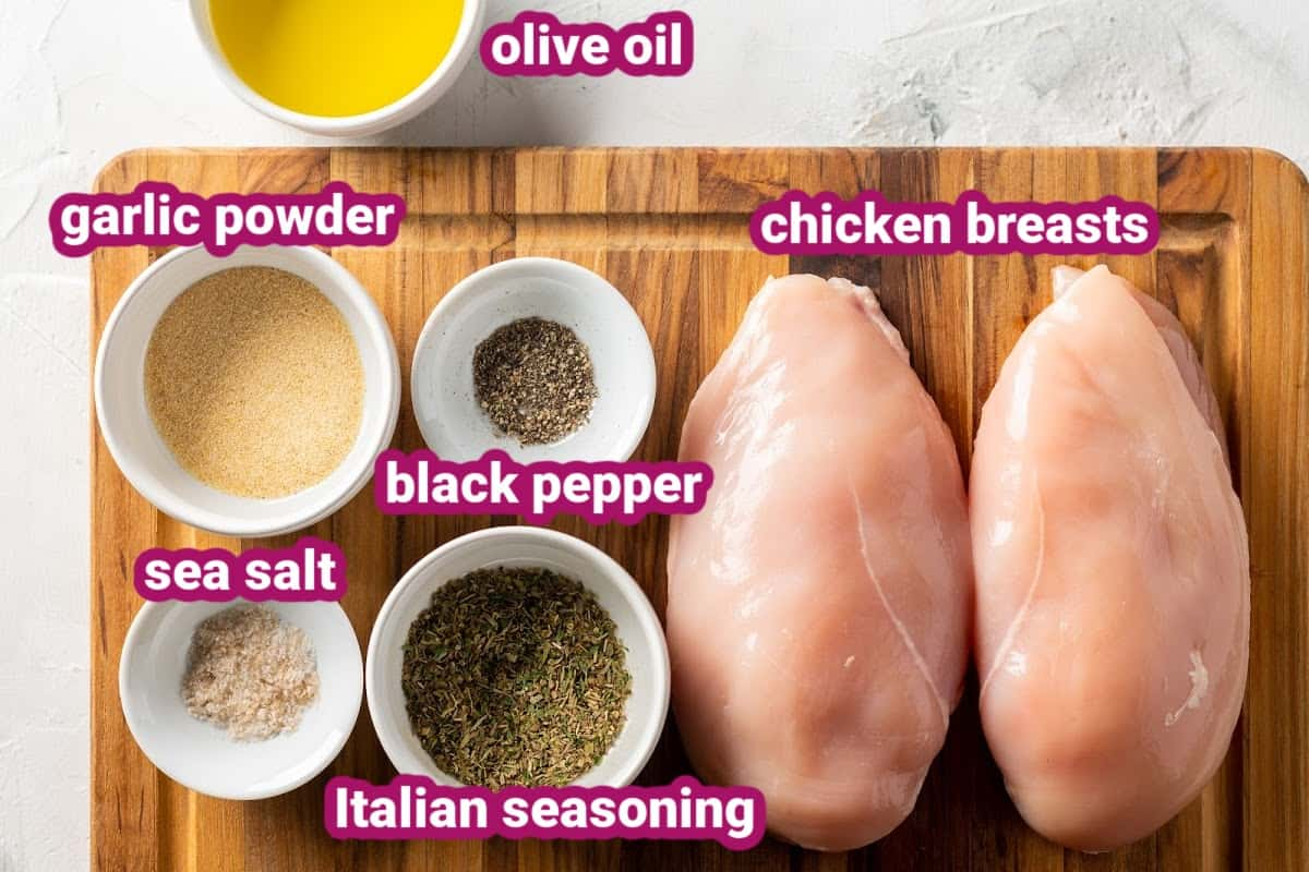a photo of the ingredients for cast iron chicken breasts, including olive oil, garlic powder, black pepper, salt and Italian seasoning.