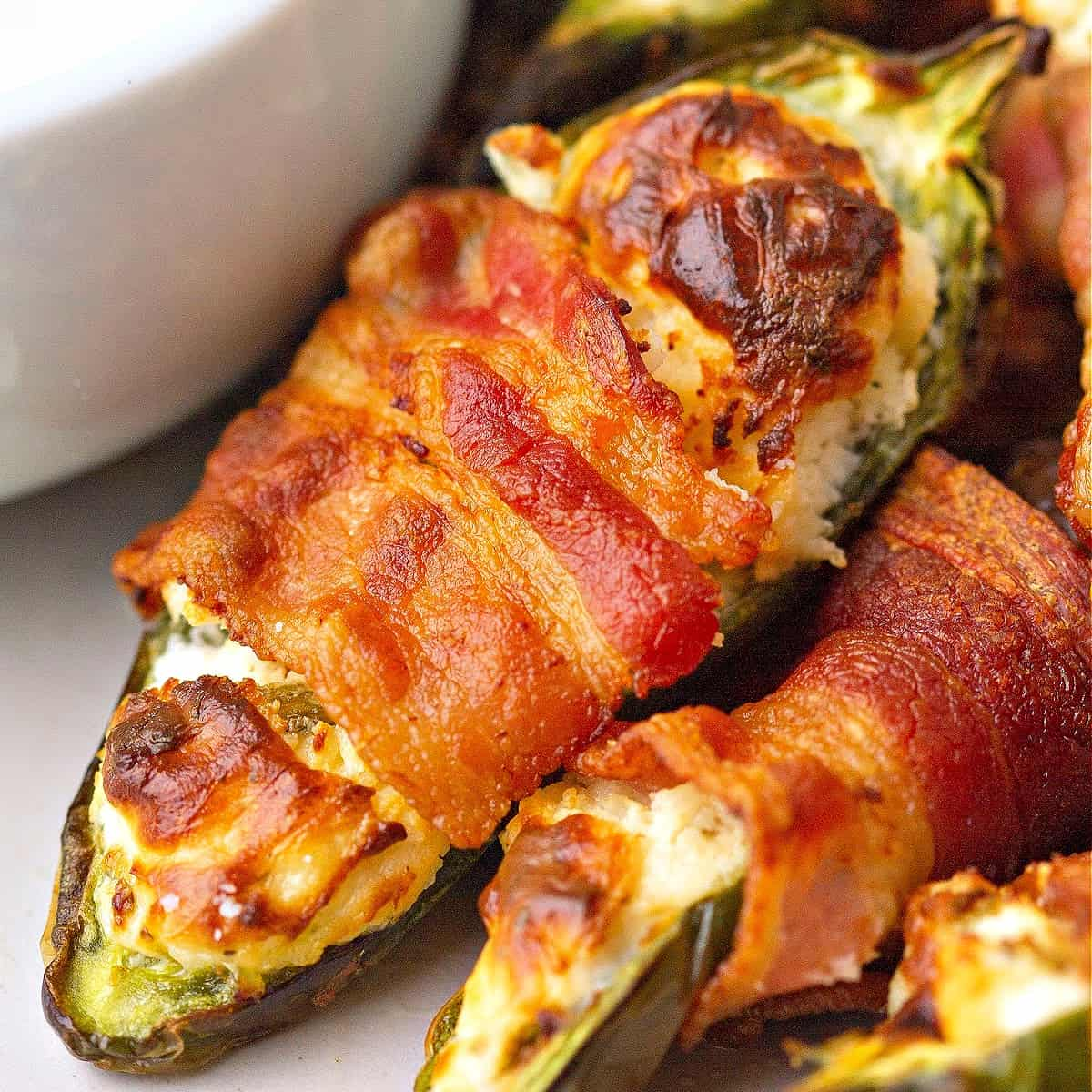 a close-up of a keto jalapeno popper on a plate