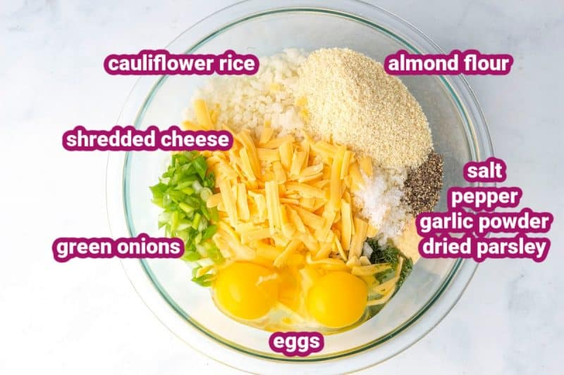 the ingredients for cauliflower hash browns in a bowl