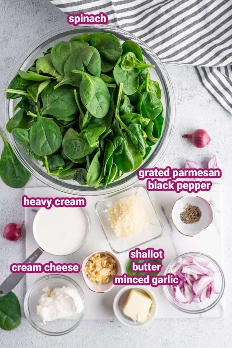 a photo of the ingredients for this keto creamed spinach recipe like spinach, heavy cream, grated parmesan, cream cheese, shallots, butter and garlic