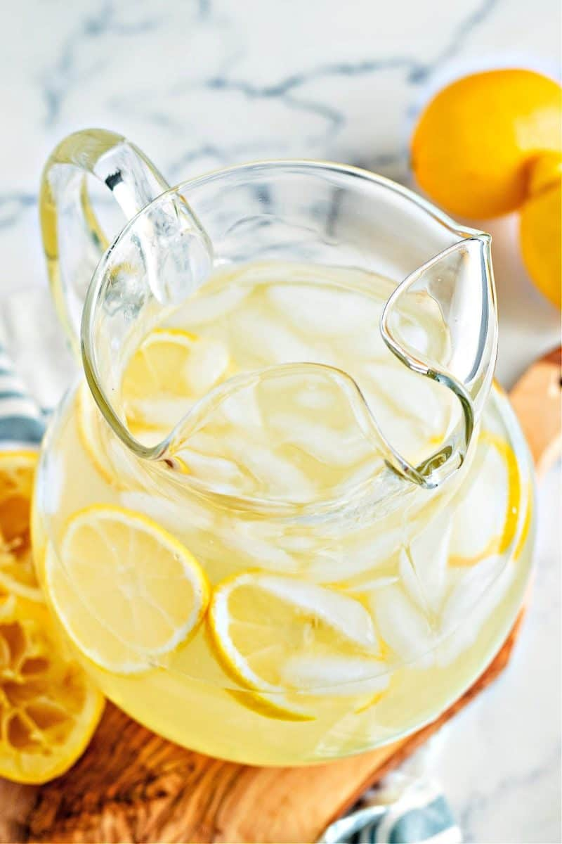 a vertical image of keto lemonade in a pitcher