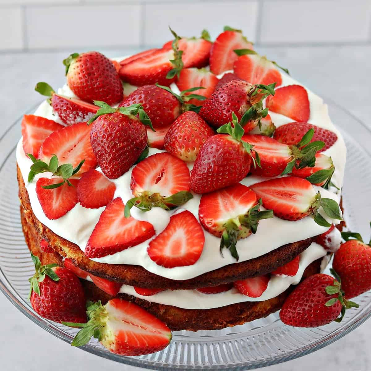 double layer low carb strawberry shortcake on a cake stand