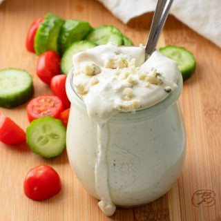 close-up of homemade blue cheese dressing in a glass jar