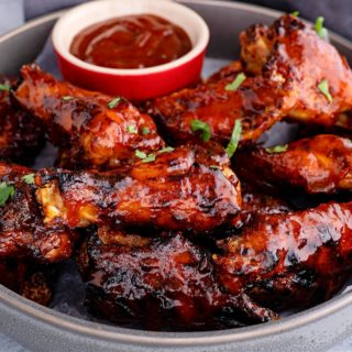 close-up of air fryer keto bbq chicken wings in a metal pan