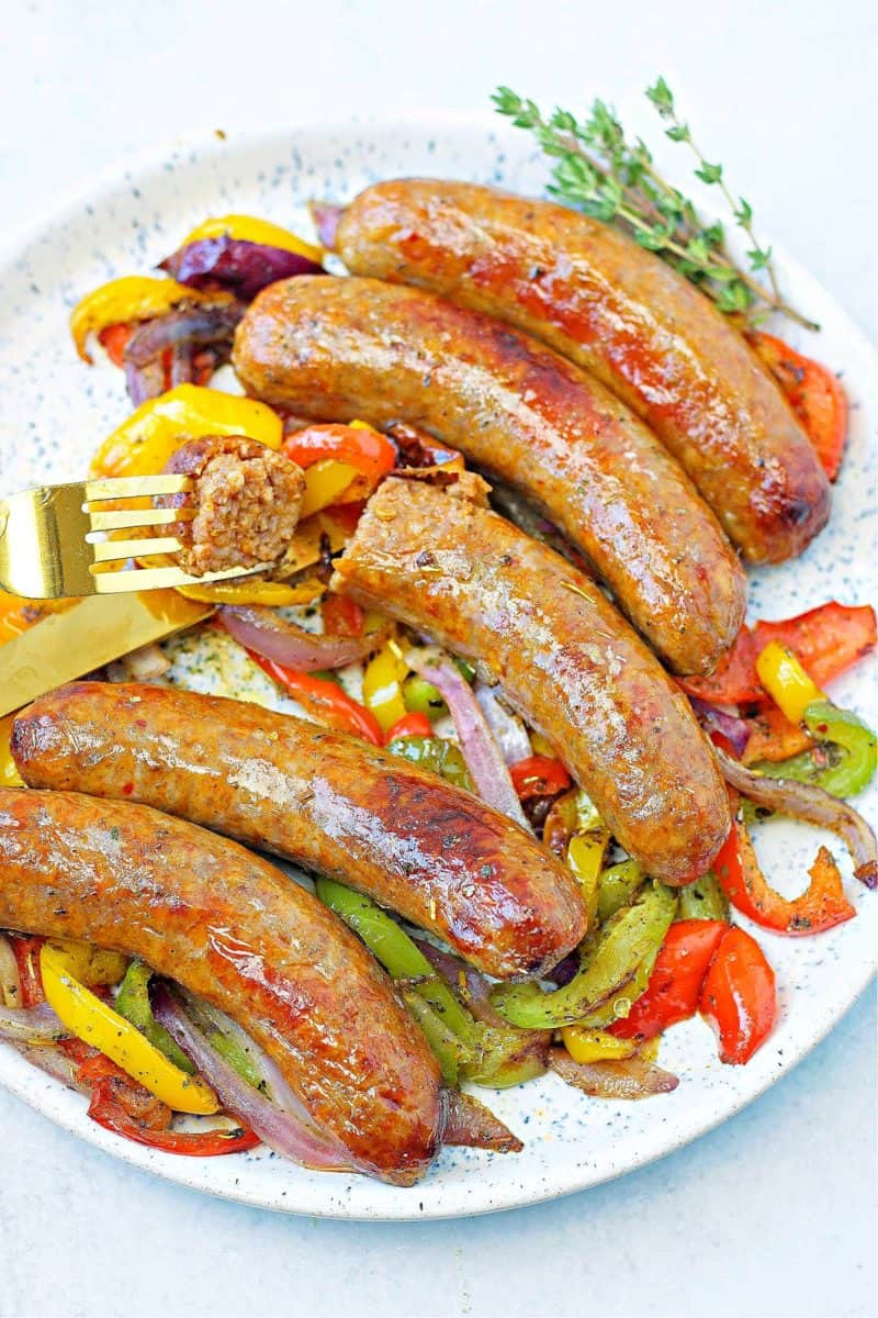 a plate of air fryer Italian sausages with peppers and onions