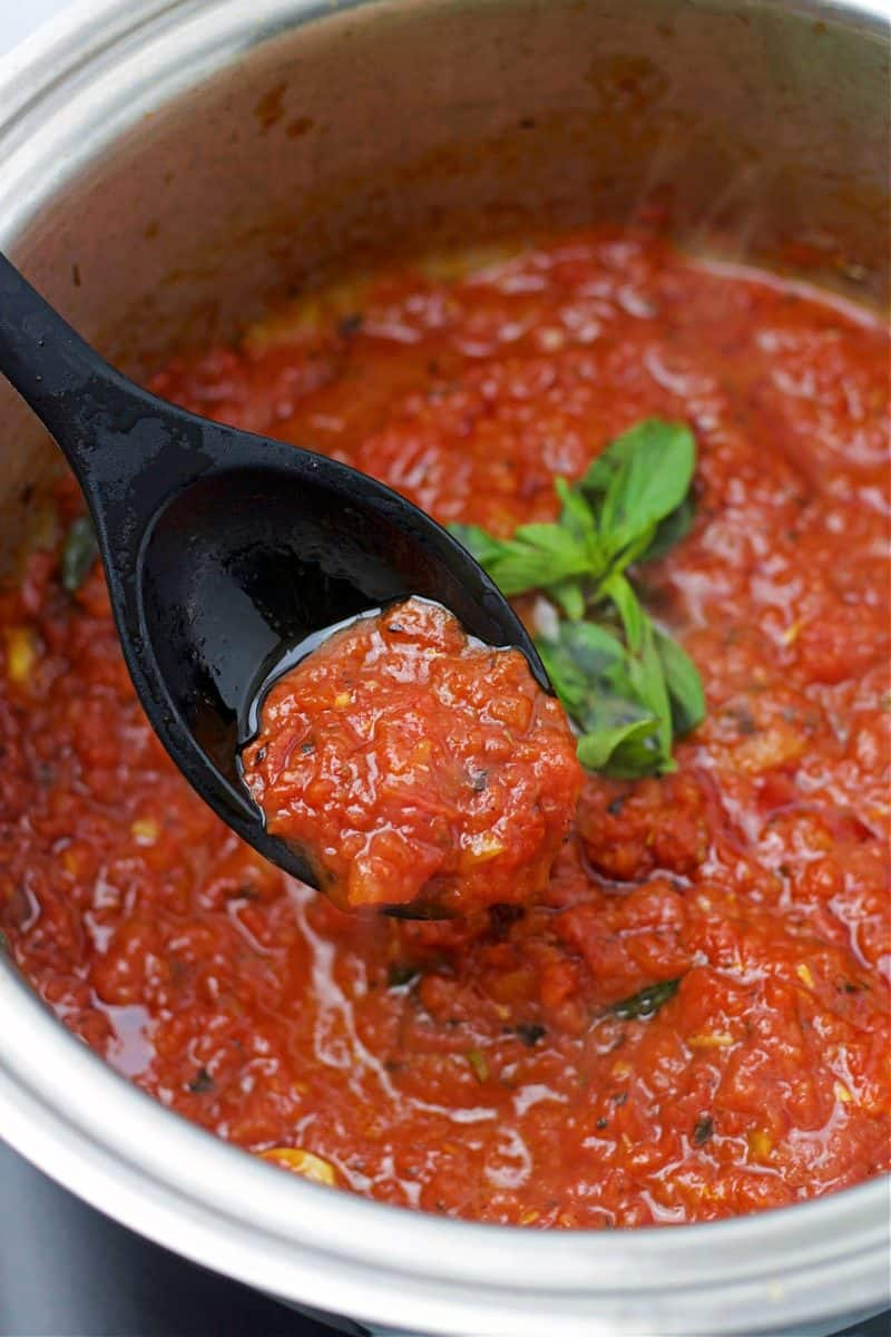 keto no sugar added marinara in a stainless steel pot with a spoon