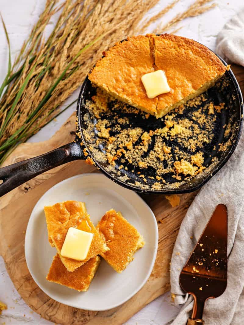 keto cornbread on a plate and in a cast iron skillet