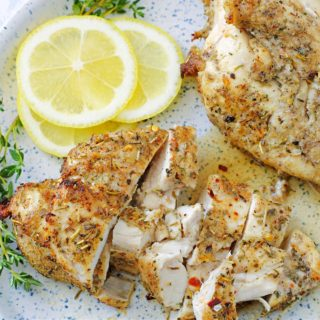 air fried chicken breasts on a plate with a squeeze of lemon